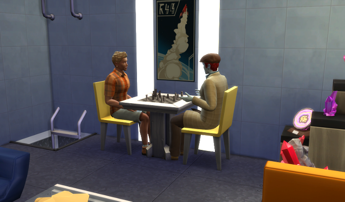 Michel and Adam are chatting while playing chess.