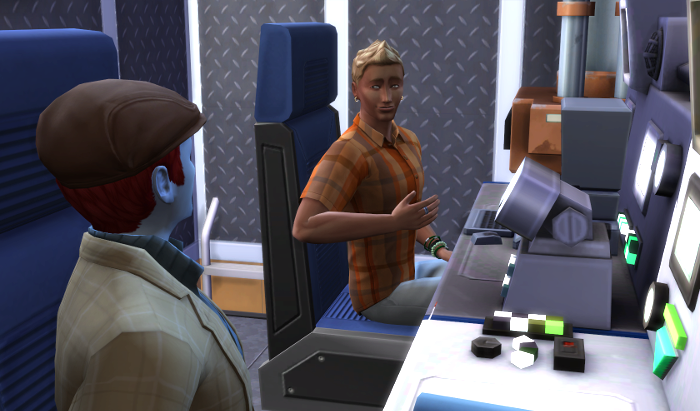 Both men are sitting at the ship consoles. Adam is wearing his hat and coat, Michel (from the Pigglewiggles) He's an adult here, blond, and an orange shirt with a big smile. Behind him is the hatch to the rest of the ship.
