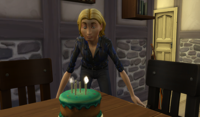 Sam blows out his cake