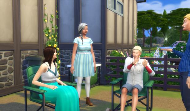 Sam, Eli, Chana, Karen, and Sam stand and sit around the fire.