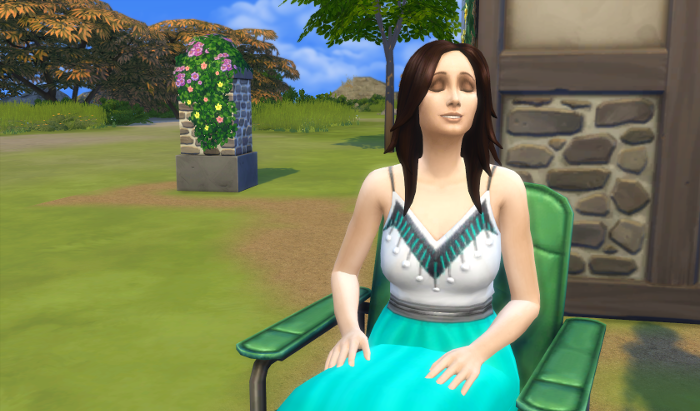 Karen is smiling. Karen has dark hair, very pale skin, and is wearing a teal and white dress.