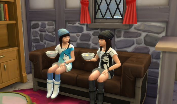 The twins are sitting on the couch, cereal bowls in hand, smiling.