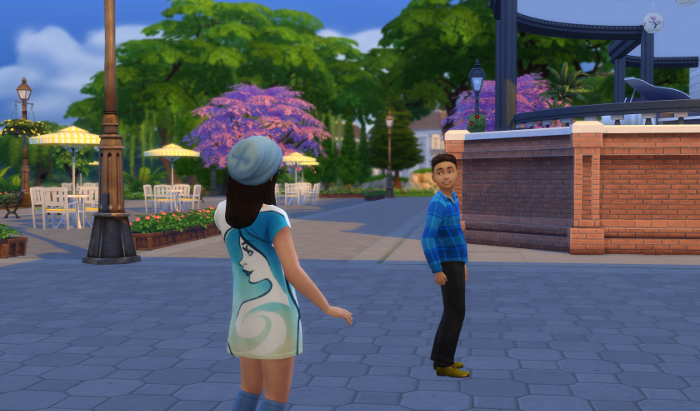 Outside (in Willow Creek) Elisa waves a a young boy in blue.