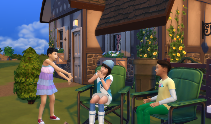 The three children are around the fire (unpictured). The boy and Elisa sit in the chairs, The other girl is standing up to tell a story.