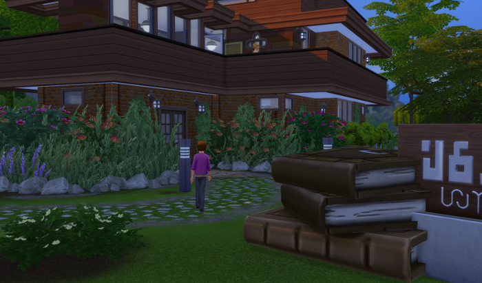Julia is walking into a very pretty brick and wood library with flowers and a nice path.