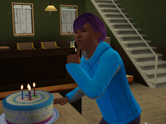 Basil thinking before he blows out the candles on his birthday cake.