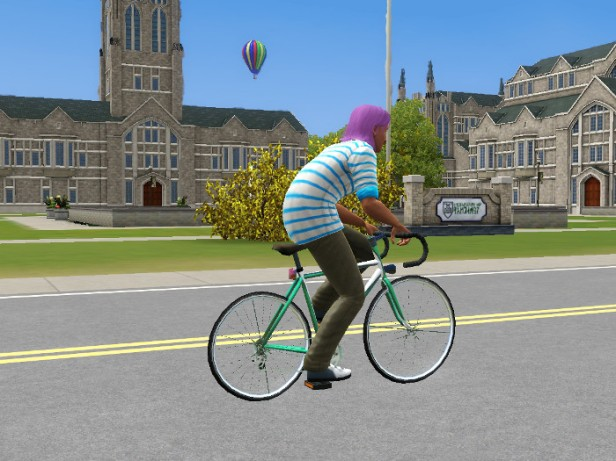 Basil on his bicycle, the school buildings loom behind.