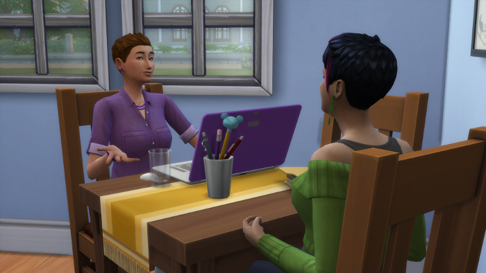 Bre and Julia are chatting at the kitchen table. Julia is talking.