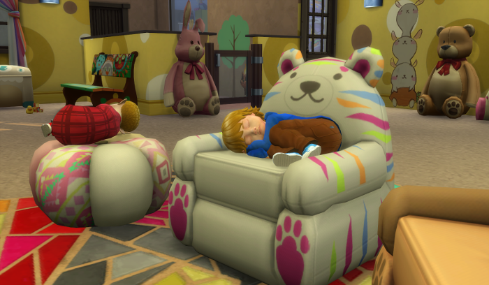 Sam and Arty have curled up on the big rainbow cat ... bear? chair and the bohemian poof.