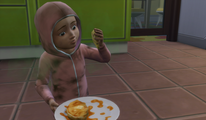 Julia sits on the floor in a dirt stained pink onsie, stench raising from her diaper, pile of syrupy pancakes in one hand.