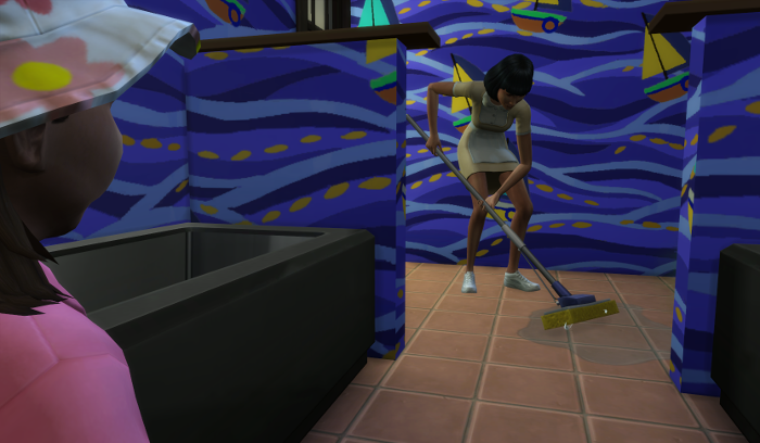 The maid mops up the bathroom floor.