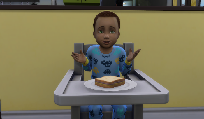 Cocoa in his blue pjs looks overly excited about the pbj in front of him.