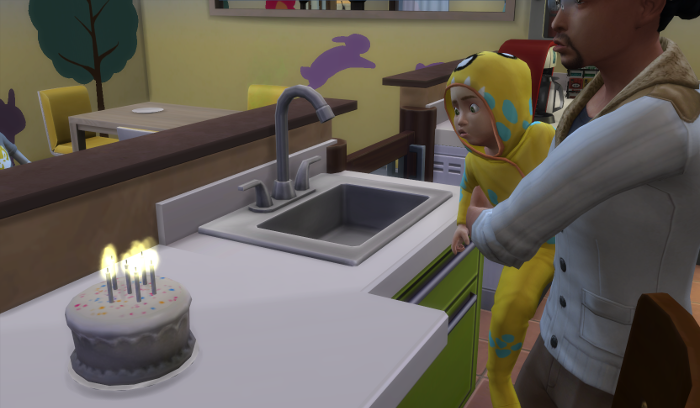 Raerei is blowing out her candles, all puffy cheeked. :)
