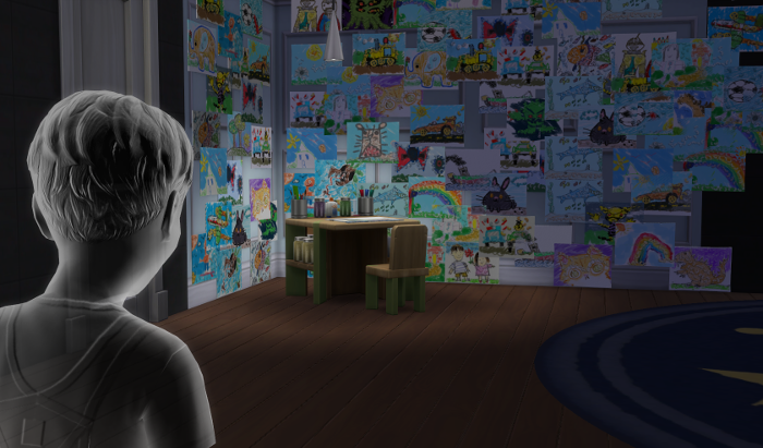 James in his room, in the distance is his coloring corner and paintings.