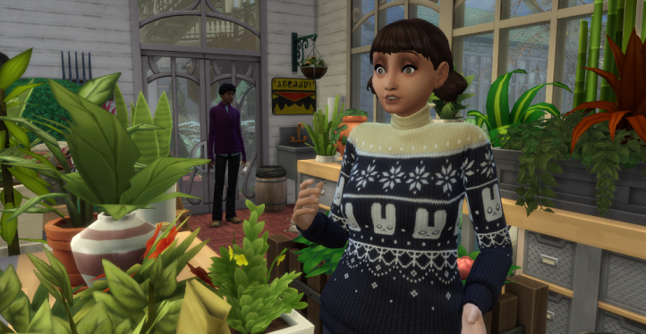 Evelyn jumps as the man behind her suddenly speaks. They're in a plant filled room.