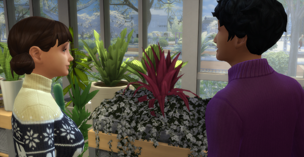 Lane and Evelyn are standing in front of a sickly plant. Pink fronds but white leaves.