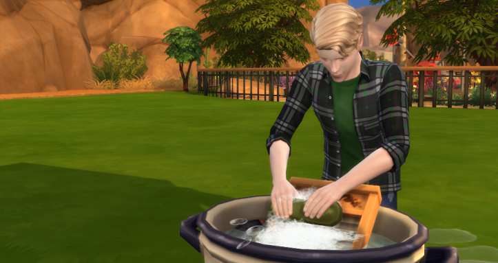 Oz doing laundry in a bucket. He was good to do this autonomously.