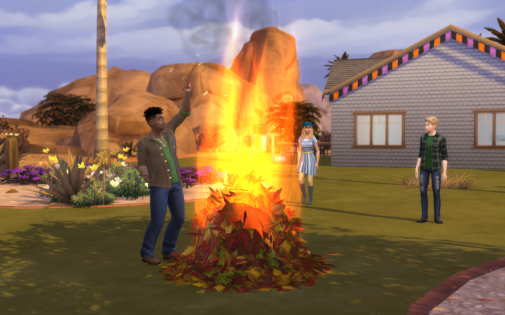 Bonfire outside, Skye is celebrating the buring the leafpile. Oz and Kierra are watching.