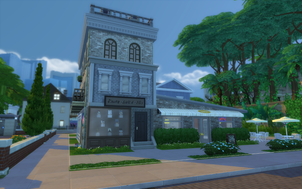 Focusing on the left side of the bakery  - the apartments, bookstore, and you can just see the widows of the laundry mat.