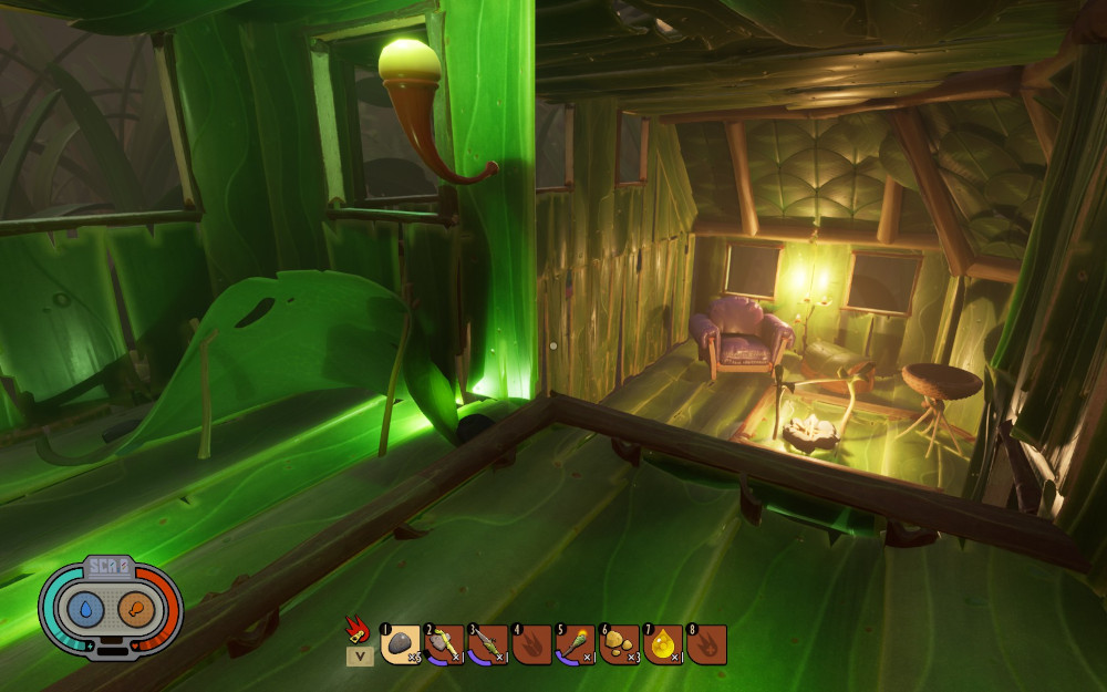 Upstairs in the green glow of the sleeping nook, downstairs you can see a homey armchair in front of a roasting spit and smoothie maker.